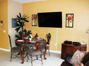 "Enjoy our beautiful dining room that also has a large 50"" Plasma TV so you won't miss a thing!"