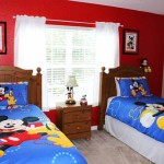 Mickey Themed Room has 2 twin beds and an extra twin mattress for added flexibility