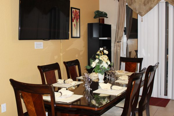 """Enjoy our beautiful dining room that also has a large 50"""" Plasma TV so you won't miss a thing!"""