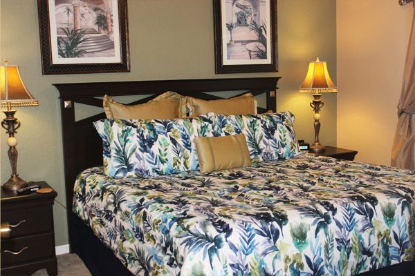"""The Master bedroom Suite has a king-size bed, 46""""plasma TV, nightstand with lamp, clock/radio/alarm, a dresser and a full private adjoining bath"""